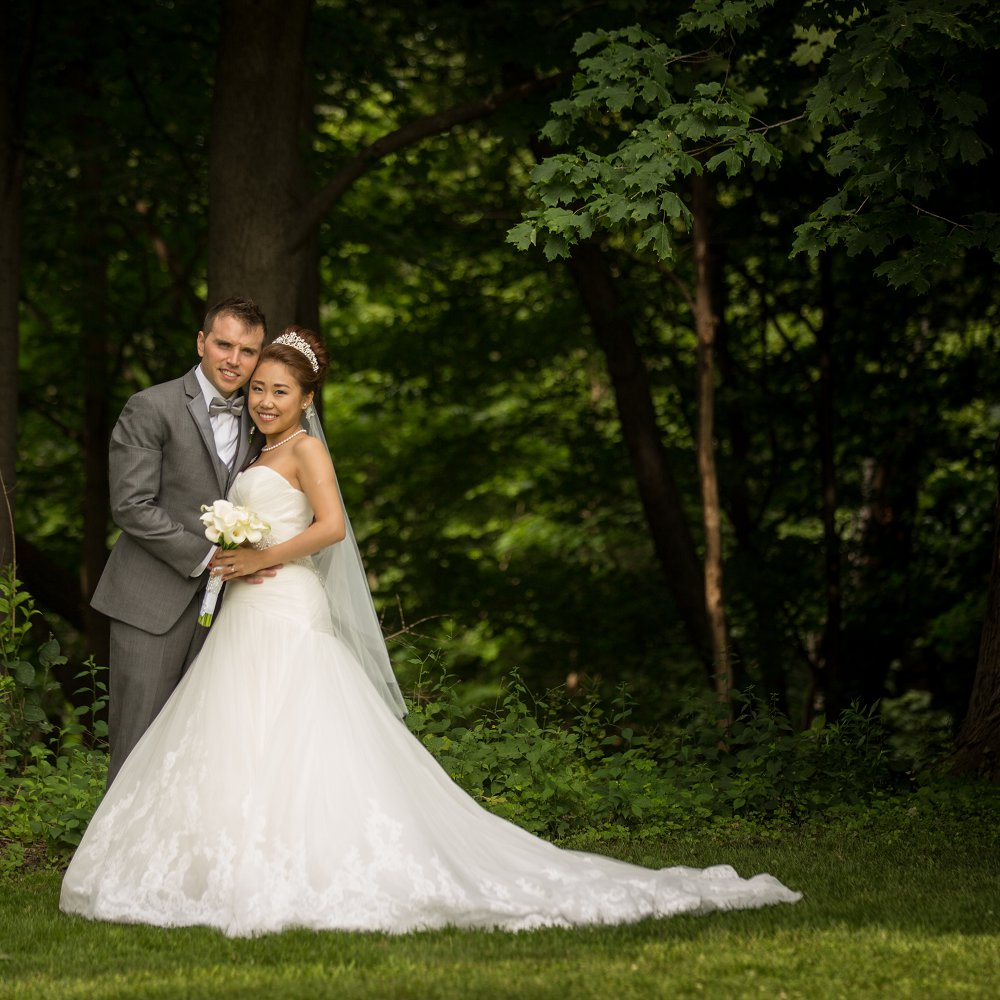 Bride and groom in the gardens at the estates of sunnybrook