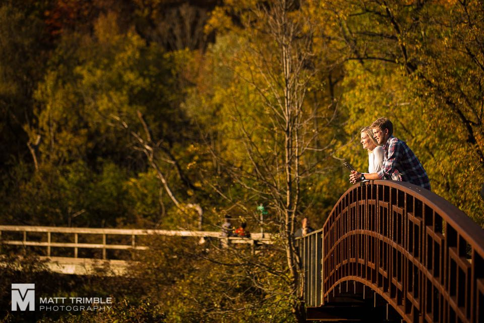 couple looking off a bridge at Grindstone Marsh