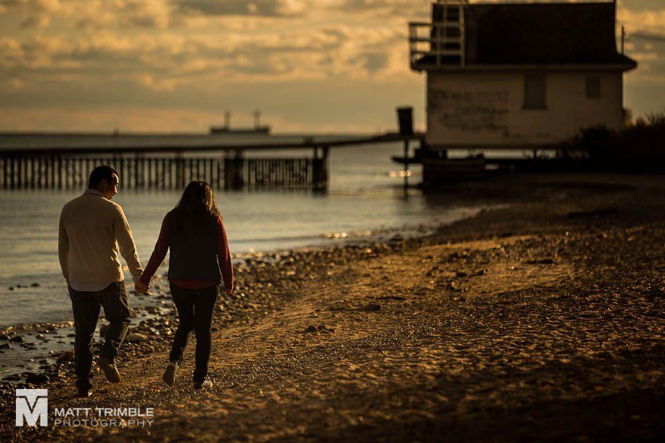 walking along cherry beach engagement