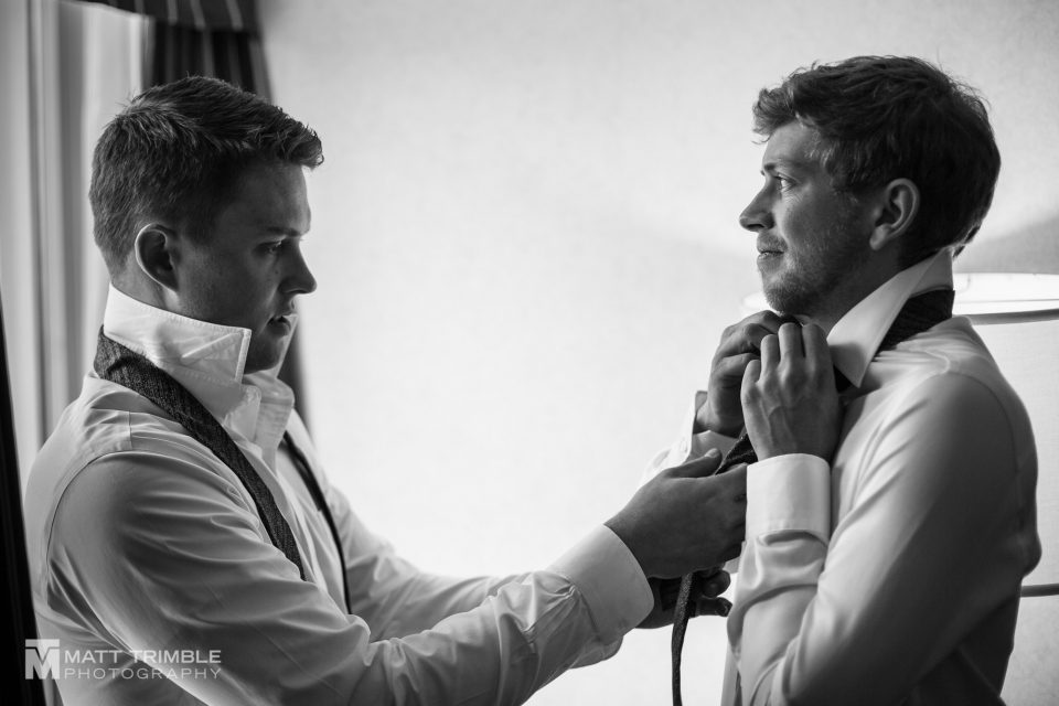 groom getting ready gambrel barn wedding