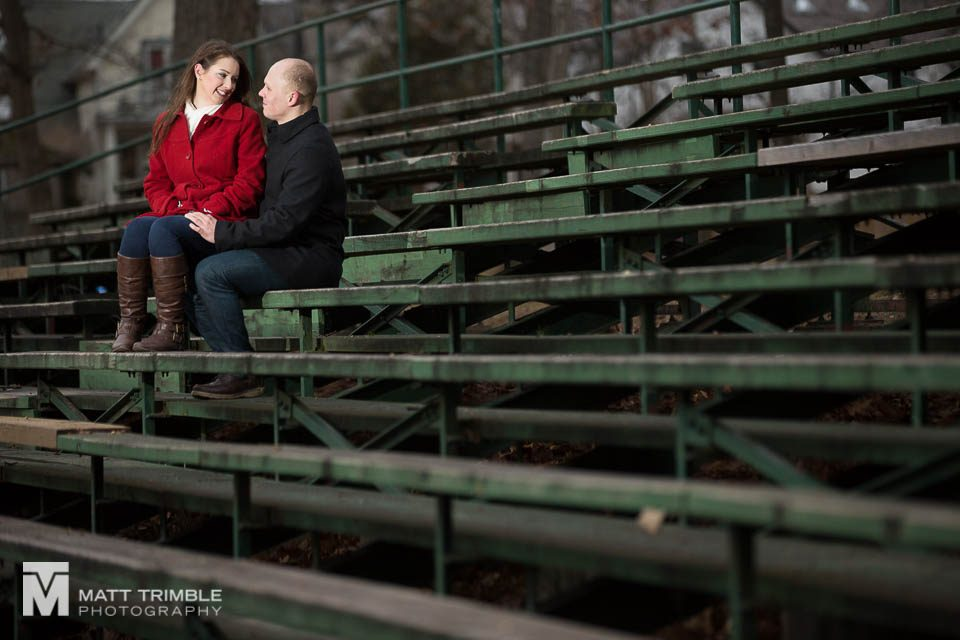 sitting on the bleachers winter engagement photography