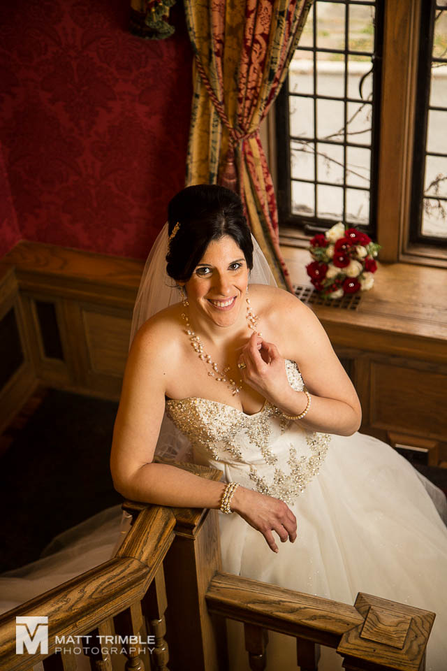 bride portrait on staircase bob rumball manor wedding
