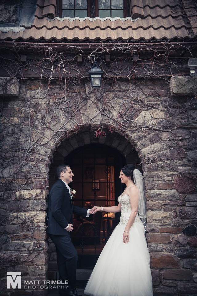 bride and groom portrait in arch bob rumball manor