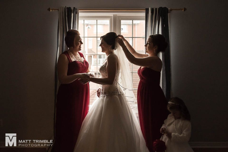 silhouette of bride getting ready