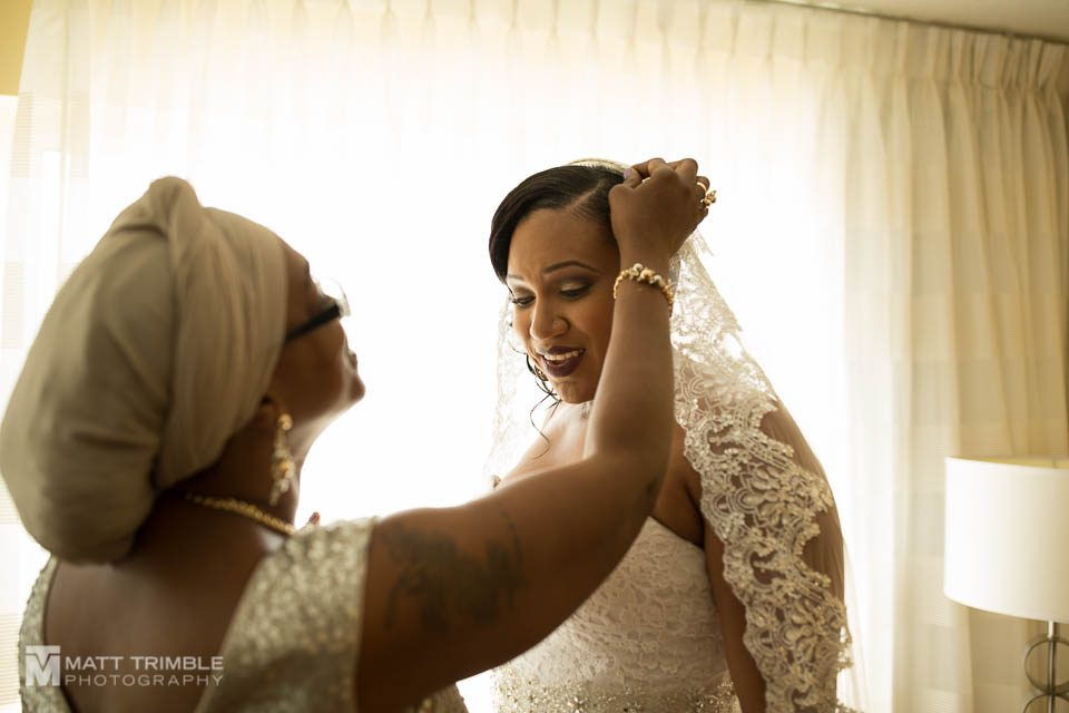 bride and mom getting ready for wedding