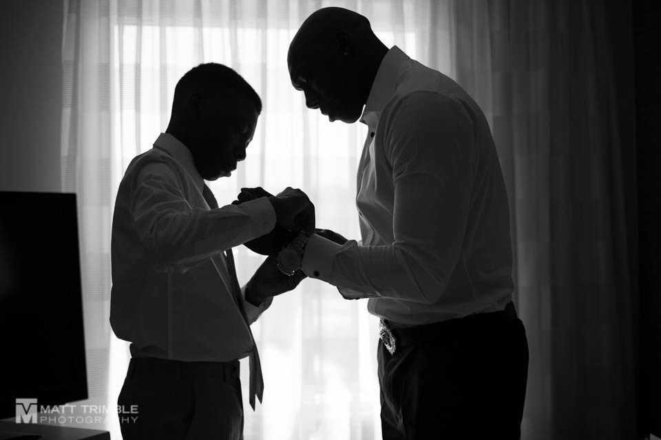 groom and son getting ready
