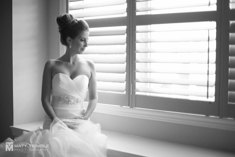 bridal portrait sitting in the window
