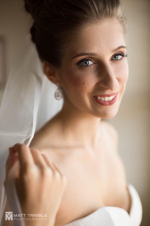 bride portrait window wedding