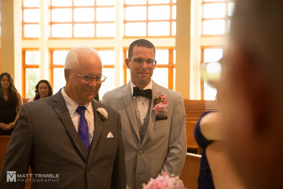 groom crying when seeing bride coming down the aisle