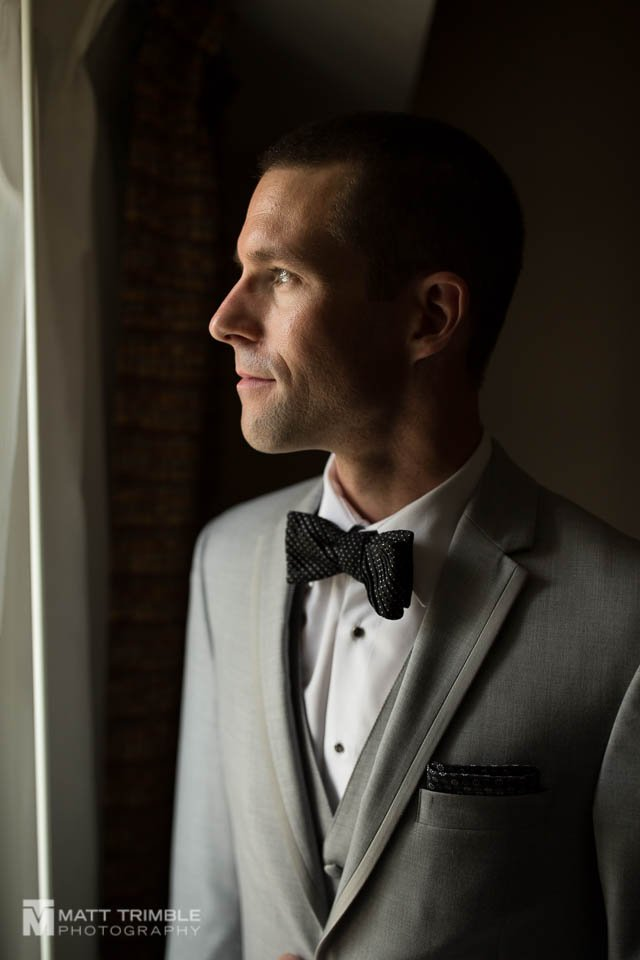wedding portrait of groom in profile