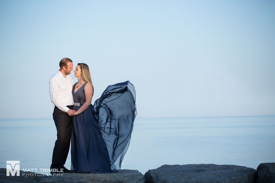 scarborough bluffs engagement photo on rocks by lake