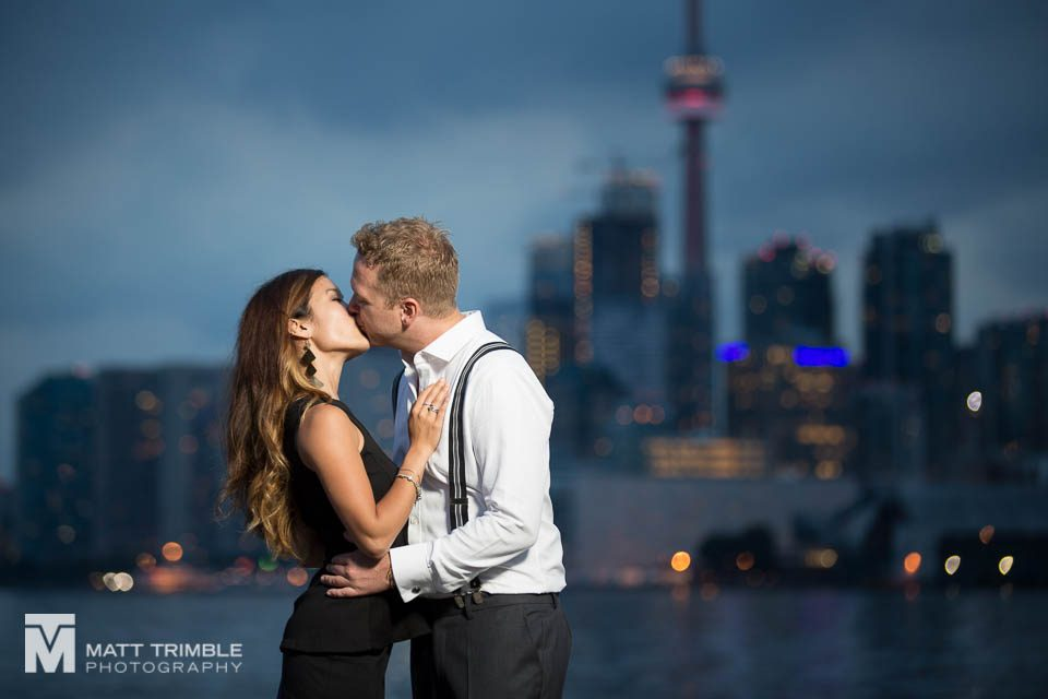 engagement photo with toronto skyline polson pier