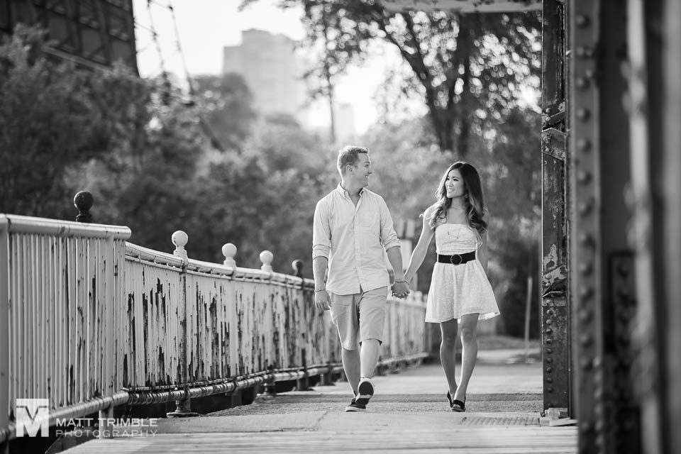 black and white engagement photo walking toronto