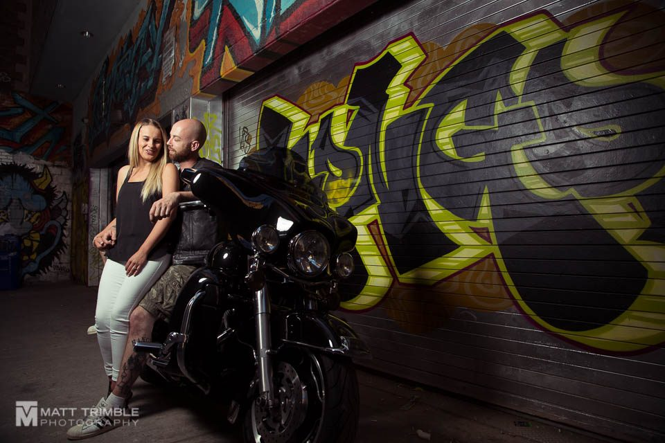 graffiti alley toronto engagement photo with motocycle