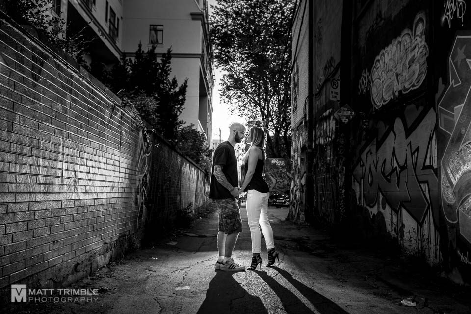 blacklit engagement photo in graffiti alley toronto