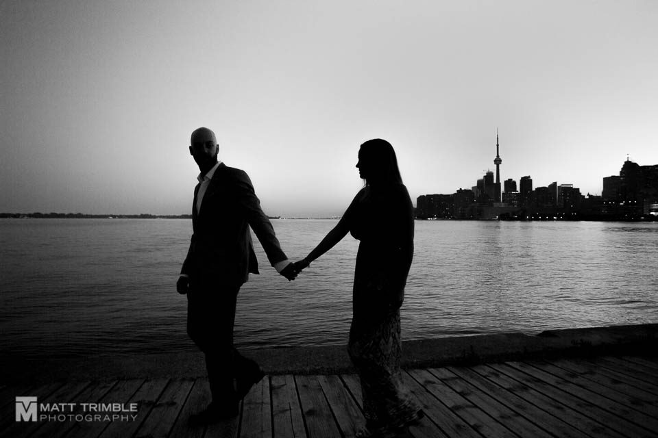 Toronto skyline silhouette with engagement couple