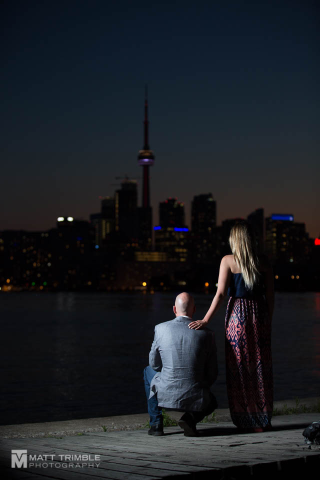 night engagement photo looking over the toronto skyline